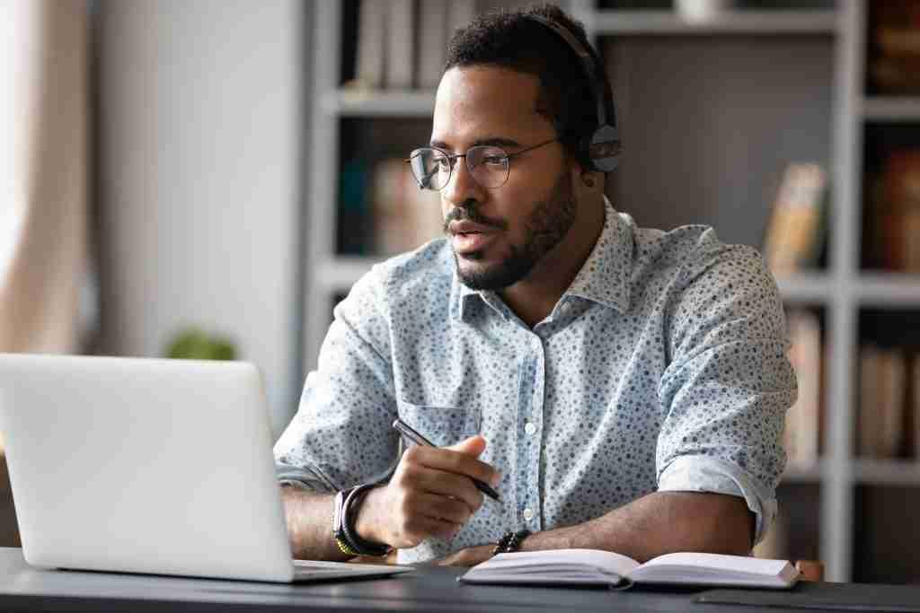Image of a man learning online through the TutorOcean Corporate Employee platform